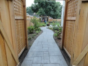 Cement Sidewalk Replacement, stamped decorative concrete, cedar fence, cement repair, stamped concrete, sidewalk replacement, cement contractor