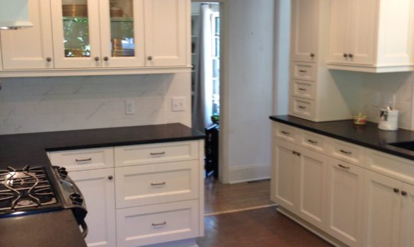 Kitchen Remodel St. Paul, MN. granite countertops. white maple cabinets. cork flooring. tiled kitchen backsplash. updated plumbing. electrical and appliances.