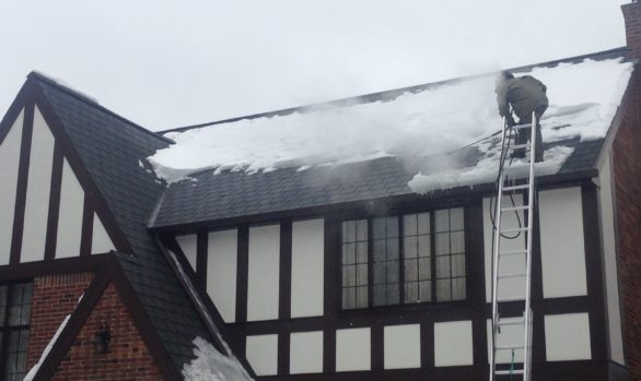 Removing Ice Dams, Man on roof steaming ice dam