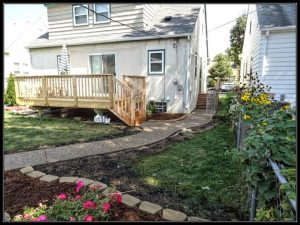 Cedar deck and curved cement sidewalk project, exteriors