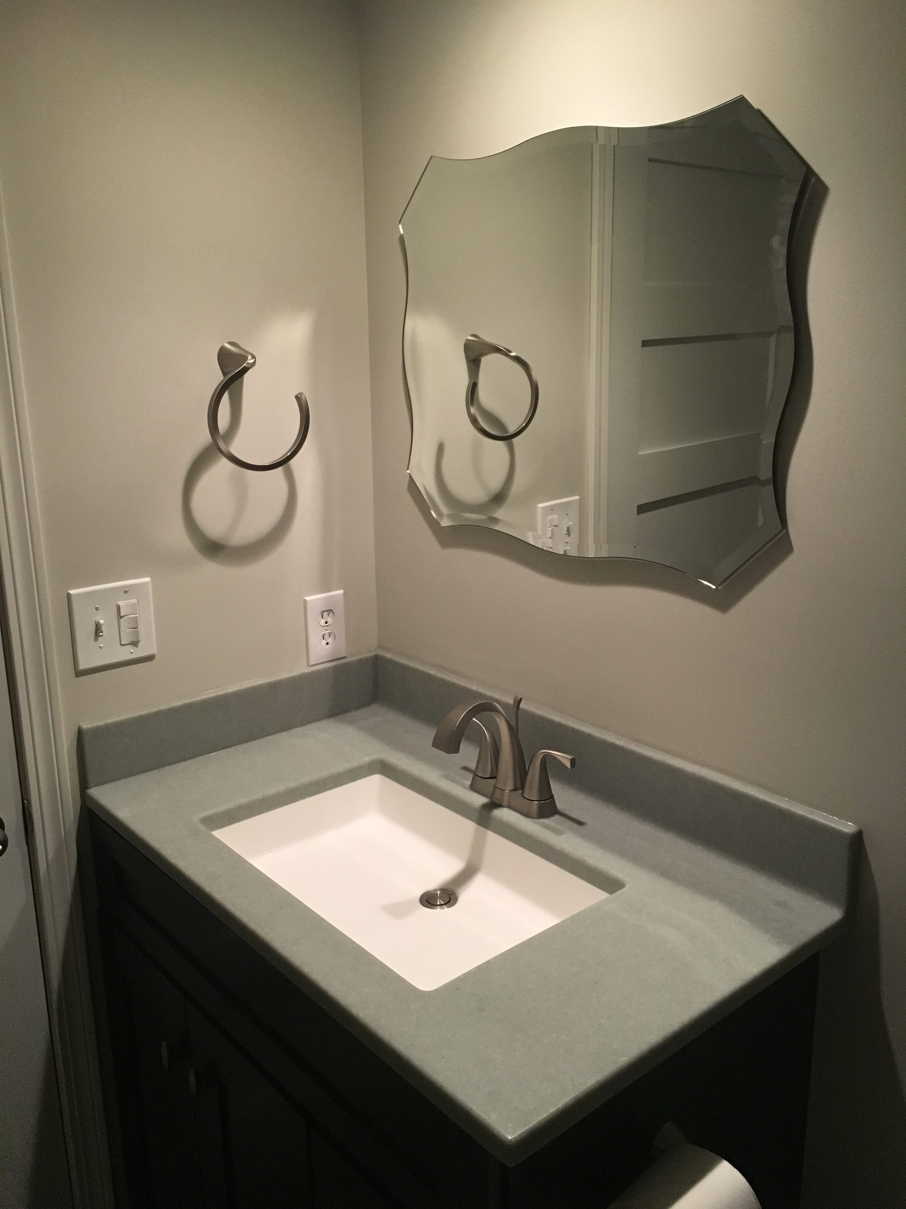 Onyx Collection sink and vanity counter top, mocha vanity cabinet, brushed nickel faucet, moen faucet