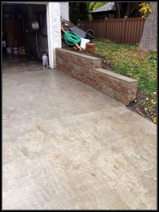 cement driveway with retaining wall